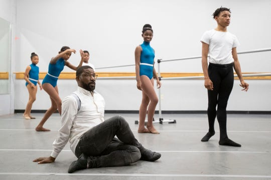 Artistic Director Kevin Thomas leads his students through a routine Thursday, Oct. 17, 2019, during a dance practice at Collage Dance Collective in Memphis.