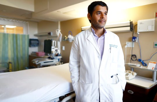 """Dr. Muhammad Raza, who specializes in hematology and oncology internal medicine, poses for a portrait at Baptist Memorial Hospital-Memphis on Friday, Oct. 18, 2019. """"I think it is a game-changing treatment for scleroderma patients,"""" Raza said of the stem cell transplant. """"This is historically a very, very tough disease to treat."""""""