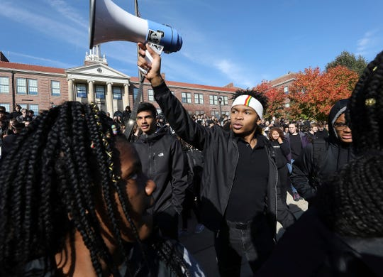 Madison West High School senior Noah Anderson, 17, president of the school's Black Student Union and son of the school's recently fired security guard Marlon Anderson, leads a rally in support of his father outside the school in Madison on Friday.