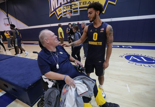 Marquette Golden Eagles guard Markus Howard  talks with long-time fan Mark Laing during Marquette University men's basketball media day.