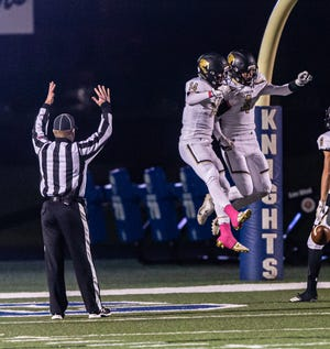 Franklin wide receiver Mitch Alba (4) celebrates his touchdown with Keaton Arendt (14) during the game at Oak Creek on Thursday, Oct. 17, 2019.