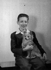 A youthful Bruce Ferguson is pictured with Beanie, a pomeranian, who's bark was bigger than his bite.
