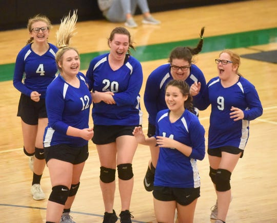 Cotter junior high players celebrate winning their second match at the 2A-North District Tournament on Thursday night.
