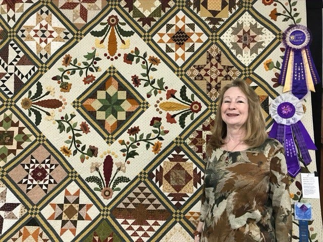 Carmen Tesch of Protem, Mo., won best of show honors at this year's Autumn in the Ozarks quilt show. This was the third Hill 'N Hollow Quilters Guild show at which she has won Best of Show. Her stunning quilt and nearly 300 other entries will be displayed at the quilt show, concludes Saturday, Oct. 19, in the Baxter County Fairgrounds' Educational Building in Mountain Home. In addition to the quilts and other entries, the show features unique gifts and quilting supplies offered by vendors and guild members, lunch and snacks provided by the Patchwork Extension Homemakers Club, a quilt raffle and a live auction of decorated boxer shorts benefiting Peitz Cancer Support House.  For more information, contact Vicki Kauth at (870) 421-5369.