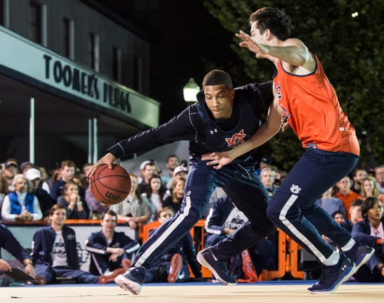 Auburn's Samir Doughty makes a move during the inaugural Auburn basketball Tipoff at Toomers in Auburn, Ala., on Thursday, Oct. 17, 2019.