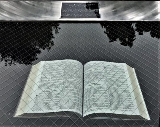 Bible behind glass on a pedestal at Montgomery Plaza
