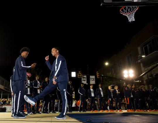 Auburn basketball players take the court during the inaugural Auburn basketball Tipoff at Toomers in Auburn, Ala., on Thursday, Oct. 17, 2019.