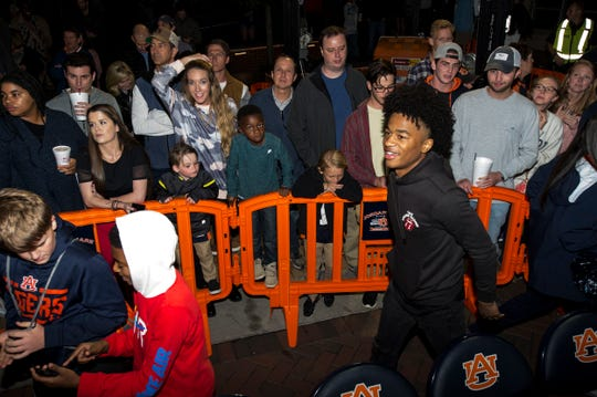 Auburn basketball signee Sharife Cooper joins fans during the inaugural Tipoff at Toomer's event in Auburn, Ala., on Thursday, Oct. 17, 2019.