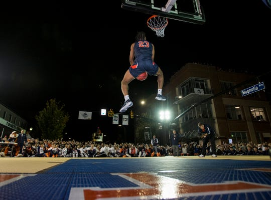 Auburn's Isaac Okoro competes in the dunk contest during the inaugural Auburn basketball Tipoff at Toomers in Auburn, Ala., on Thursday, Oct. 17, 2019.
