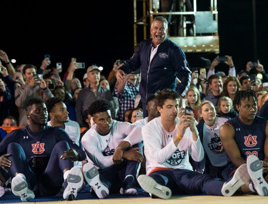 Auburn head men's basketball coach Bruce Pearl  reacts to the dunk contest during the inaugural Auburn basketball Tipoff at Toomers in Auburn, Ala., on Thursday, Oct. 17, 2019.