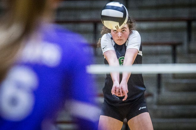 FILE -- Yorktown's Jenny Morey digs a ball in a sectional match against Central at New Castle High School Thursday Oct. 17, 2019.