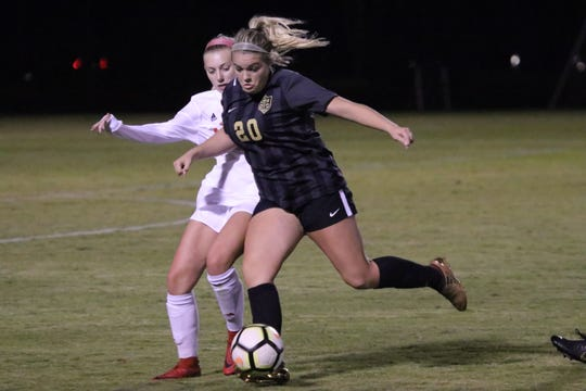 Central Magnet's Ella Chesney (20) gets into a kick during Thursday's 1-0 win over Page in the 11-AA title match.