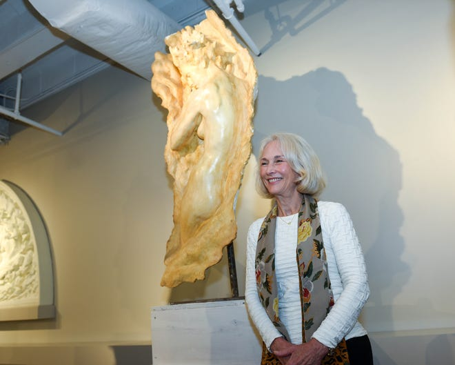 """Sculptor Frederick Hart's widow, Lindy Hart, stands next to a piece, """"Ex Nihilo, Figure No. 6,"""" that she posed for. The sculpture is in the Frederick Hart Studio Museum in the Lila D. Bunch Library."""