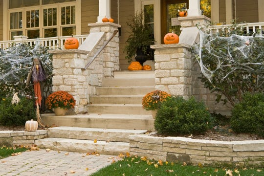 If your home is on the market this Halloween season, stick with a few simple decorations and pops of seasonal color.