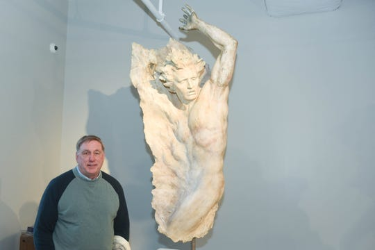 "David Hytla, sculptor Frederick Hart's longtime friend and business partner, poses next to the piece that he posed for decades ago. The sculpture is ""Figure No. 4."" Hytla visited the Frederick Hart Studio Museum in the Lila D Bunch Library at Belmont University for the first time Oct. 18, 2019, as part of the university's Frederick Hart Symposium"