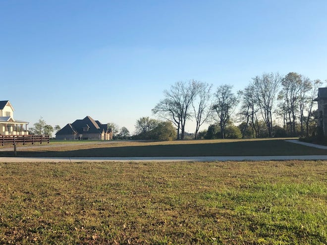 Six couples purchased 32 acres of farmland in Hendersonville and subdivided it. Each home is on 5 or 6 acres.