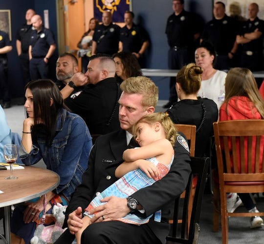 Firefighter Andy Neuens cuddles with his daughter, four-year-old Quinn, during the Newark Fire Department's 2019 Awards Ceremony on Thursday, Oct. 17, 2019, at the Fraternal Order of Police. Neuens, who was part of the Medic One crew, received a Lifesaving Citation for a traffic incident involving a pedestrian.