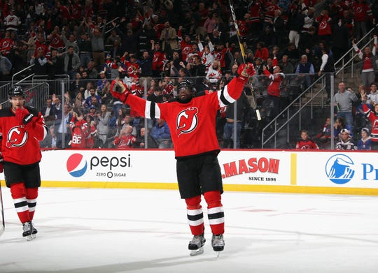 P.K. Subban #76 of the New Jersey Devils celebrates his empty net goal at 19:12 of the third period against the New York Rangers at the Prudential Center on October 17, 2019 in Newark, New Jersey. The Devils defeated the Rangers 5-2.