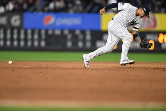 Yankees vs. Astros in Game 4 of the American League Championship Series at Yankee Stadium on Thursday, October 17, 2019. Yankees #25 Gleyber Torres is unable to field the ball in the ninth inning.