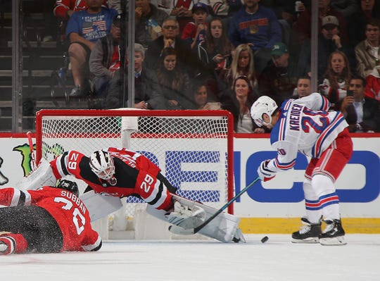 Mackenzie Blackwood #29 of the New Jersey Devils makes the second period save on Chris Kreider #20 of the New York Rangers at the Prudential Center on October 17, 2019 in Newark, New Jersey.