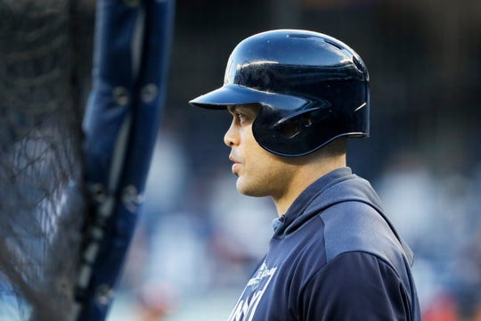 New York Yankees left fielder Giancarlo Stanton watches batting practice before Game 5 of baseball's American League Championship Series against the Houston Astros Friday, Oct. 18, 2019, in New York. (AP Photo/Matt Slocum)