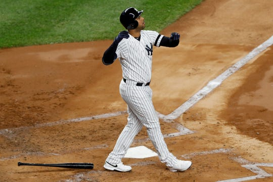 New York Yankees' Aaron Hicks watches his three-run home run against the Houston Astros during the first inning in Game 5 of baseball's American League Championship Series Friday, Oct. 18, 2019, in New York.