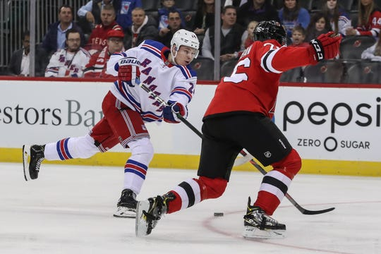 Oct 17, 2019; Newark, NJ, USA; New York Rangers right wing Kaapo Kakko (24) shoots the puck while being defended by New Jersey Devils defenseman P.K. Subban (76) during the first period at Prudential Center.