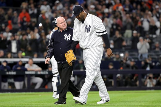 CC Sabathia #52 of the New York Yankees walks off the field as he comes out of the game against the Houston Astros during the eighth inning in game four of the American League Championship Series at Yankee Stadium on October 17, 2019 in New York City.
