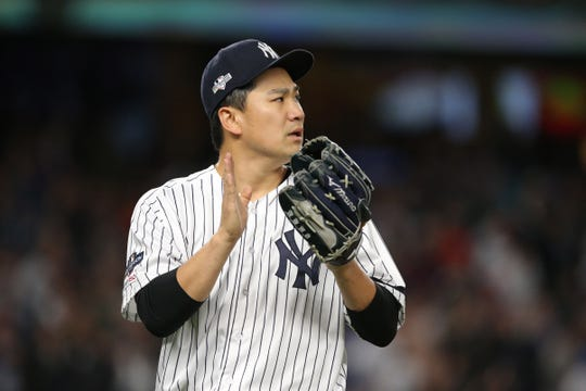 Oct 17, 2019; Bronx, NY, USA; New York Yankees starting pitcher Masahiro Tanaka (19) reacts after Yankees right fielder Aaron Judge (not pictured) makes a diving catch on a ball hit by Houston Astros left fielder Michael Brantley (not pictured) during the fifth inning in game four of the 2019 ALCS playoff baseball series at Yankee Stadium. Mandatory Credit: Brad Penner-USA TODAY Sports