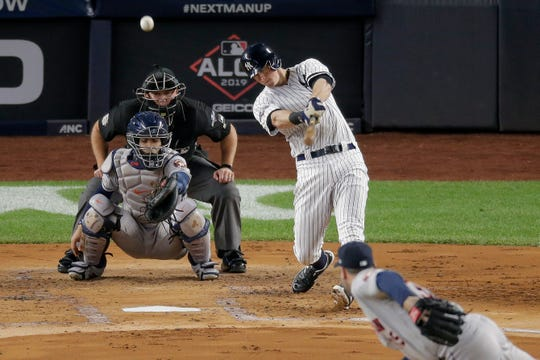 New York Yankees' DJ LeMahieu connects for a solo home run against the Houston Astros during the first inning of Game 5 of baseball's American League Championship Series, Friday, Oct. 18, 2019, in New York.
