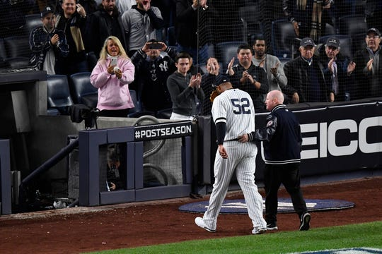 Oct 17, 2019; Bronx, NY, USA; New York Yankees pitcher CC Sabathia (52) is walked off the field by a member of the training staff after suffering an apparent injury against the Houston Astros during the eighth inning of game four of the 2019 ALCS playoff baseball series at Yankee Stadium. Mandatory Credit: Robert Deutsch-USA TODAY Sports