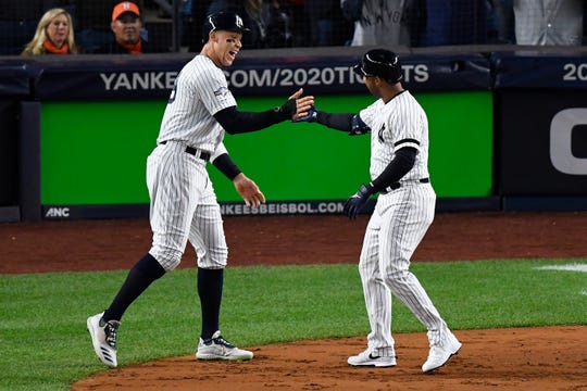 Oct 18, 2019; Bronx, NY, USA; New York Yankees center fielder Aaron Hicks (right) celebrates with right fielder Aaron Judge (left) after hitting a three run home run against the Houston Astros during the first inning of game five in the 2019 ALCS playoff baseball series at Yankee Stadium.