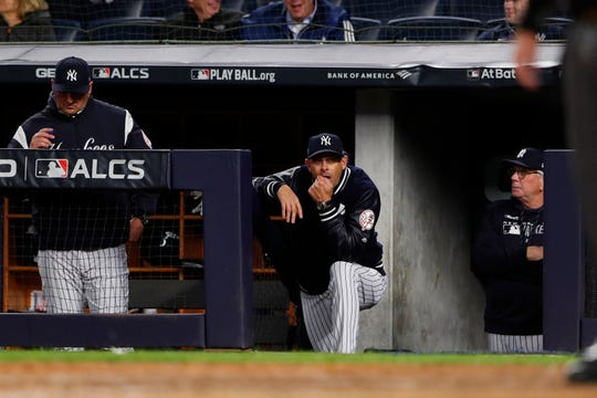 Oct 17, 2019; Bronx, NY, USA; New York Yankees manager Aaron Boone (17) looks on during the ninth inning of game four of the 2019 ALCS playoff baseball series against the Houston Astros at Yankee Stadium.