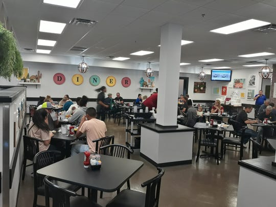 Customers dine at Weck's on opening day, Friday, Oct. 18, 2019.