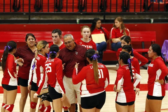 Loving coach Mo Cordova talks to the Lady Falcons during a timeout in Thursday's match against Eunice.