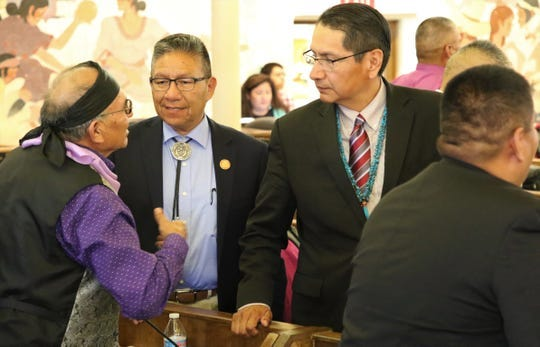 Delegate Eugene Tso, left, speaks with Navajo Nation Vice President Myron Lizer and President Jonathan Nez after the State of the Nation address on July 15 at the tribal council summer session in Window Rock, Arizona.