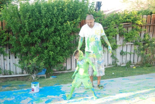Sergio Guzman during a family paint fight. Guzman was  convicted of participating in a criminal street gang, family and friends say he's never been a member of a gang.