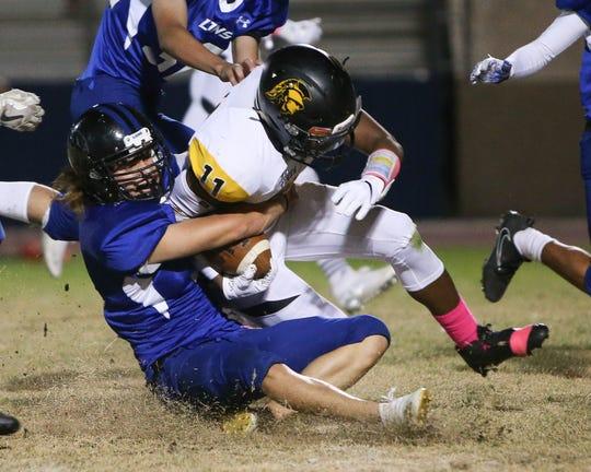 Ushon Goodson (#11) getting tackled.
