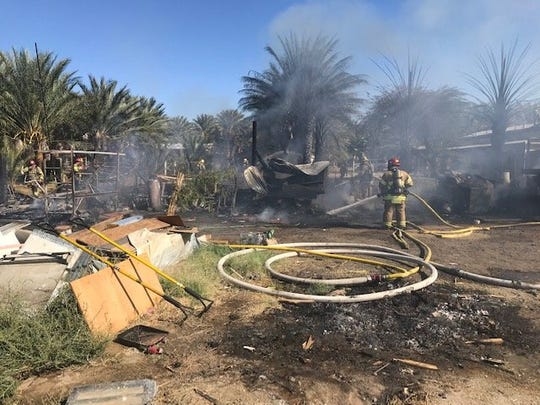 The blaze destroyed two mobile homes, a vehicle and an outbuilding, according to Cal Fire.