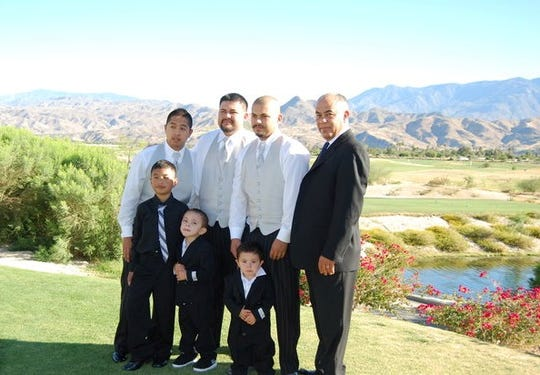 Sergio Guzman, second from right, is pictured with family members at a wedding. Guzman faced a life sentence for robbery until the court was notified that the police officer who testified against him was under investigation.