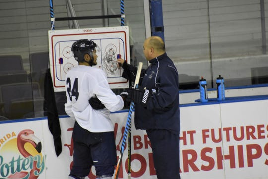 Ice Flyers coach Rod Aldoff goes over play strategy with returning winger Eddie Matsushima (24) during Tuesday's practice at the Pensacola Bay Center.