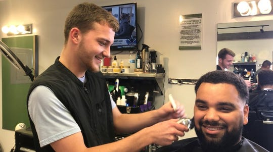 Trey Noble, of Hanover, trims Jordan King's beard at Diversified Cuts Barbershop, 16 Baltimore St., on Tuesday, Oct. 15, 2019. There are a number of salons and barbershops in downtown Hanover.