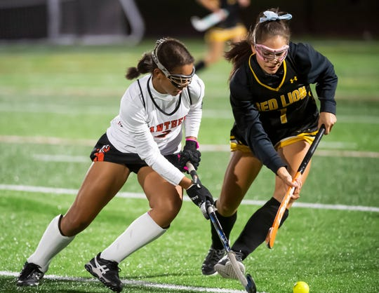 Central York's Victoria Whitehead (left) controls the ball around Red Lion's Lakelyn Smith during a YAIAA semifinal field hockey game in Littlestown on Thursday, October 17, 2019. The Panthers won 2-1.