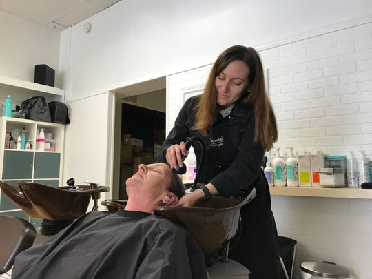 In this file photo, Amy Loughlin, of Hanover, washes Biddy Ditco's hair at Levity Salon & Spa, 12 Center Square, on Friday, Oct. 18, 2019.