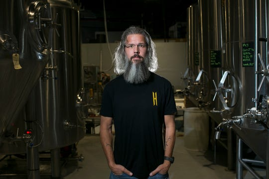 Brian Helton, the brewmaster for Helton Brewing, stands inside the company's brewery on October 11, 2019 in Phoenix, Ariz.