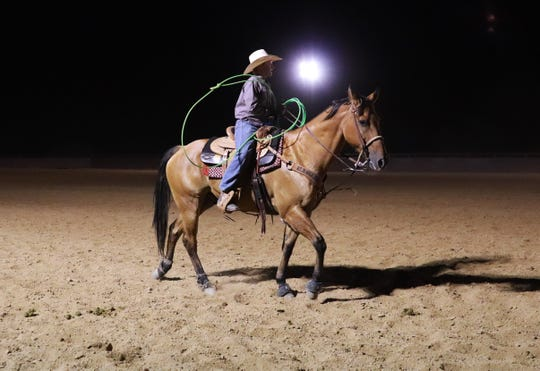 Denton on his horse, Cliff, at a Friday evening jackpot competition on October 4, 2019 in Wickenburg.