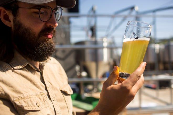 Luke Wortendyke tastes a Hydrolager at Wren House Friday, October 18, 2019 in Phoenix, Arizona.