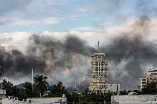 "Smoke from burning cars rises due in Culiacan, Mexico, Thursday, Oct. 17, 2019. An intense gunfight with heavy weapons and burning vehicles blocking roads raged in the capital of Mexico's Sinaloa state Thursday after security forces located one of Joaqui­n ""El Chapo"" Guzman's sons who is wanted in the U.S. on drug trafficking charges. (AP Photo/Hector Parra)"