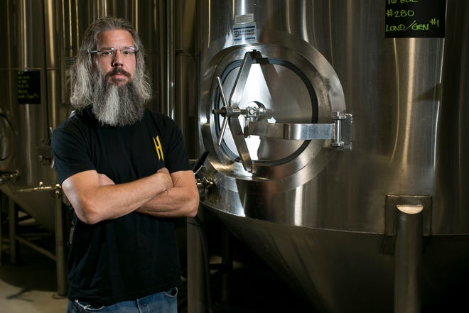 Brian Helton, the brewmaster for Helton Brewing, stands inside the company's brewery on Oct. 11, 2019, in Phoenix.