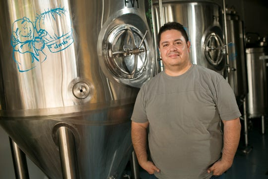Art Ruiz, the brewmaster for Desert Monks Brewing, stands in the company's production facility on September 25, 2019 in Gilbert, Ariz.